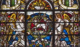 LONDON, GREAT BRITAIN - SEPTEMBER 14, 2017: The angels and the Lamb of God on the stained glass in church. St. Vedast alias Foster 1884 Royalty Free Stock Image