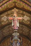 LONDON, GREAT BRITAIN - SEPTEMBER 17, 2017: The carved Crucifixion of Jeus as the king and priest in church St. Barnabas. Designed by Bodley in 1906 Stock Photography
