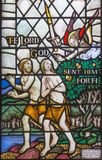 LONDON, GREAT BRITAIN - SEPTEMBER 17, 2017: The Expulsion of Adam and Eve from Paradise on the stained glass in church St. Barna. Bas by Martrin Travers 1945 Royalty Free Stock Images