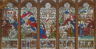 LONDON, GREAT BRITAIN - SEPTEMBER 17, 2017: The Jesus Christ as the symbolic tree of Life among the Biblical scenes in stained gla. Ss in church of Hl. Trinity Royalty Free Stock Photo