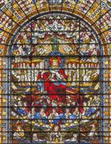 LONDON, GREAT BRITAIN - SEPTEMBER 14, 2017: The Jesus Christ the King on the stained glass in the church St. Edmund the King Royalty Free Stock Image