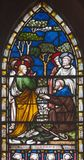 LONDON, GREAT BRITAIN - SEPTEMBER 19, 2017: The Jesus Heals Blind Bartimaeus on the stained glass in St Mary Abbot`s church stock image
