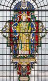 LONDON, GREAT BRITAIN - SEPTEMBER 14, 2017: St. Lawrence on the stained glass in church St. Lawrence Jewry. By Christopher Webb half of 20. cent Royalty Free Stock Photo