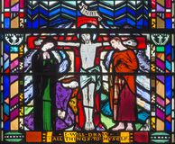 LONDON, GREAT BRITAIN - SEPTEMBER 16, 2017: The stained glass of Crucifixion in church St Etheldreda Stock Image