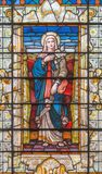 LONDON, GREAT BRITAIN - SEPTEMBER 14, 2017: The Virgin Mary on the stained glass in the church St. Edmund the King from 19. cent Stock Image