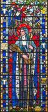 LONDON, GREAT BRITAIN - 2017: The St. Brigid of Kildare on the stained glass in church St Etheldreda by Joseph E. Nuttgens. LONDON, GREAT BRITAIN - SEPTEMBER 16 royalty free stock photography