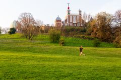 London Greenwich park with woman jogging exercise in summer. London Greenwich park with woman jogging exercise in summer royalty free stock images