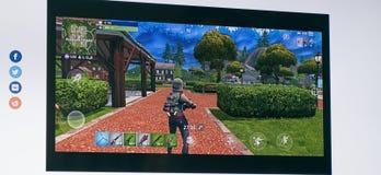 LONDON, Großbritannien - 8. April 2019 - Fortnite-Videospiel-Schirm Vierzehn Tage Battle Royale-on-line-Spiele von Epic Games stockbilder