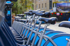 London Hire Bikes. Stock Image. A row of hire bikes lined up in a docking bay in London. Bikes introduced in July 2010 across London aiming to reduce traffic Royalty Free Stock Photography