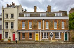 London House. London brick house with different doors Royalty Free Stock Photo