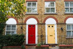 London house traditional brick wall facade and doors, UK. Europe Royalty Free Stock Photo