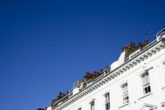London Housing. A photo of a London house group on a sky blue day Stock Photo