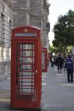 London iconic red telephone booth on sidewalk stock photos