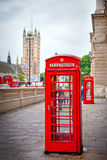 London Icons. Telephone box, double decker and Westminster Abbey after rain: icons of London Royalty Free Stock Images
