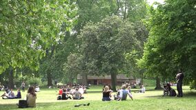 London James`s Park, People Tourists Relaxing Resting on Grass at Picnic