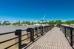 London. Jetty over Thames river on a beautiful day Royalty Free Stock Photography
