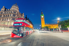 LONDON - JULY 1, 2015: Double Decker bus in Westminster. London. Attracts 30 million tourists annually Royalty Free Stock Images