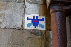 Pixel art on the Thames. London - July 29, 2017: `Galaxian` pixel art near the River Thames, by street artist `Invader royalty free stock photo