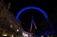 LONDON - JUNE 16: London Eye on June 16, 2012. LONDON - JUNE 16: London Eye at night on June 16, 2012 in London. London Eye is famous city landmark located near Stock Photo