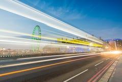 LONDON - JUNE 13, 2015: Light trails across Westminster Bridge w Stock Image