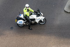LONDON - JUNE 25 : Metropoliatan Police traffic officer clearing stock image