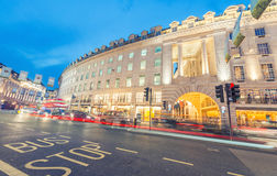 LONDON - JUNE 11, 2015: Night traffic and tourists in Regent Str Stock Image