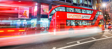 LONDON - JUNE 11, 2015: Night traffic and tourists in Regent Str Stock Photography
