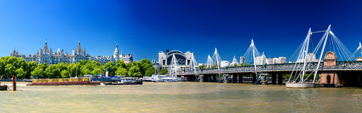 LONDON - JUNE 30, 2015: Panoramic view of Hungerford Bridge on a Royalty Free Stock Images