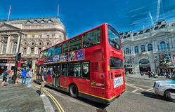 LONDON - JUNE 11, 2015: Red Double Decker Bus along city streets. It is a famous city attraction among tourists Royalty Free Stock Images