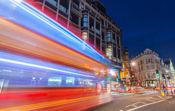 LONDON - JUNE 14, 2015: Red Double Decker Bus speeds up in city. Streets at night. These modern buses came to replace an old classic,the AEC Routemaster Stock Photos