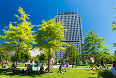 LONDON - JUNE 16, 2015: Tourists relax on Jubilee Gardens. The c Stock Photography