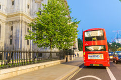 LONDON - JUNE 11, 2015: Tourists and traffic in city streets at Royalty Free Stock Image