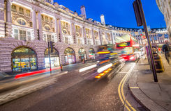 LONDON - JUNE 2015: Traffic after sunset in Oxford Street. Londo Royalty Free Stock Image