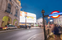 LONDON - JUNE 11, 2015: Traffic and tourists at night in Regent Stock Photo