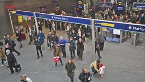 London Kings Cross station with commuters traveling to work stock footage