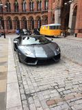 London Lamborghini. A grey Lamborghini aventador in a stone paved driveway Royalty Free Stock Photos