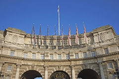 London Landmark. Admiralty Arch decorated with White Ensign flags in central London, England, United Kingdom Stock Images