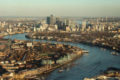 London landscape with Canary Wharf. Canary Wharf viewed from high London viewpoint on a sunny day. Boats are crossing the river Royalty Free Stock Photos