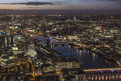 London landscape at night. Modern buildings of London, aerial view at night. Bridges around Thames Stock Photography