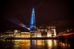 London landscape at night, showing the Shard building. London landscape at night, showing the Shard building with laser lights Stock Photography
