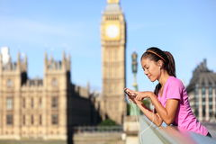 London lifestyle woman listening to music, Big Ben Stock Image
