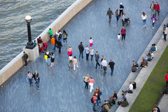 LONDON, Lots of people walking by river Thames. City of London in weekend Royalty Free Stock Image