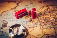 London map with Big Ben, double decker bus in miniature and comp Royalty Free Stock Photo