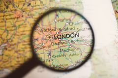 London on a Map Through Magnifying Glass. Map london closeup magnifying glass close-up cartography uk Royalty Free Stock Image