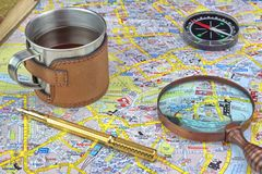 London Map And Travel Items. Magnifying Glass, Compass, Notes and Gold Fountain Pen Royalty Free Stock Photo