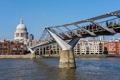 LONDON - MAR 13 : Millennium Bridge and St Pauls Cathedral in Lo. Ndon on Mar 13, 2016. Unidentified people Royalty Free Stock Photography