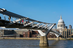 LONDON - MAR 13 : Millennium Bridge and St Pauls Cathedral in Lo. Ndon on Mar 13, 2016. Unidentified people Stock Photo