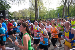 The London Marathon. Some of the thousands of runners in the Famous London Marathon race make their way through the streets in Greenwich on April 17, 2011 in Royalty Free Stock Photo
