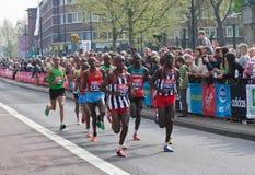 London Marathon 2011. Virgin London Marathon 2011 (17 April 2011) - leading group of runners, including male winner - Emmanuel Mutai (Kenya) and runner-up Royalty Free Stock Image