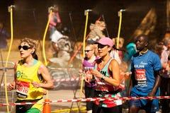 London Marathon Runners. Marathon Runners Pass Water Spray Royalty Free Stock Photography